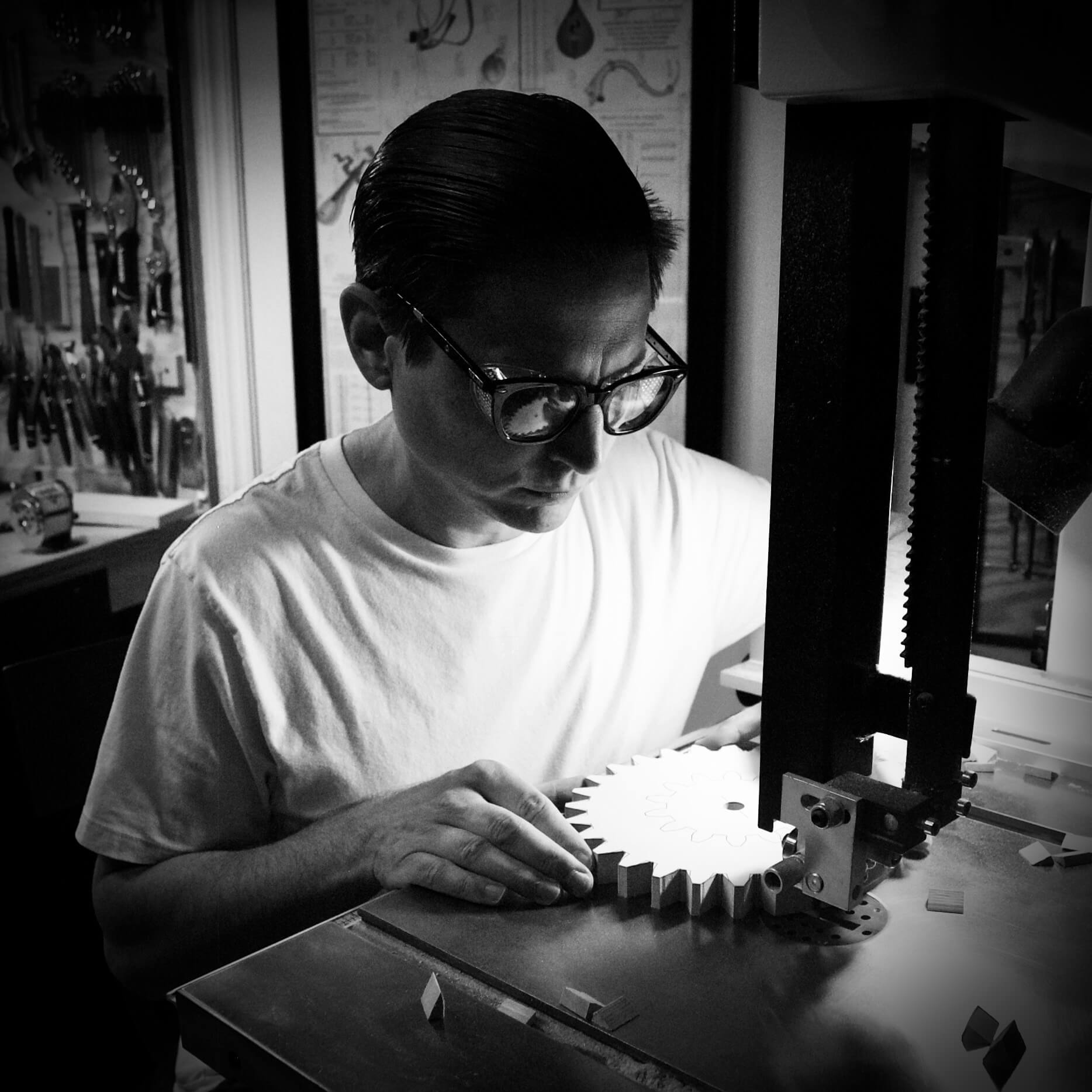 Ben making gears image in black and white
